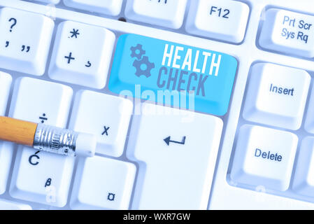 Writing note showing Health Check. Business concept for Medical Examination Wellness and general state Inspection White pc keyboard with note paper ab - Stock Photo