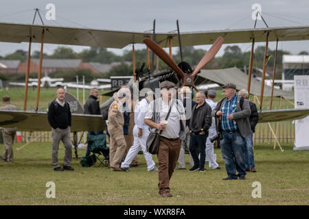 Royal Aircraft Factory BE2 British single-engine tractor two-seat biplane on display at the Goodwood Revival classic car show. - Stock Photo