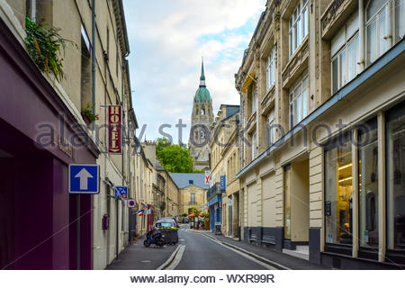The tower and dome of the medieval Cathedral of Our Lady of Bayeux, a Roman Catholic church located in the town of Bayeux in Normandy, France. - Stock Photo