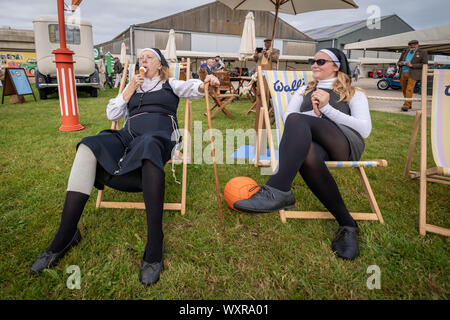 Vintage-themed Goodwood Revival. Britain's greatest annual classic car show celebrates the mid-20th-century heyday of the Goodwood racing circuit. - Stock Photo