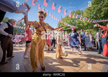 Rock and roll dancing at the vintage-themed Goodwood Revival, Britain's greatest annual classic car show, UK