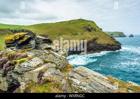 Spectacular views from the top of Warren point near Boscastle Harbour entrance with Willapark Lookout ahead, North Cornwall, England, UK. - Stock Photo