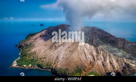 Approaching White Island / Whakaari volcano by helicopter. Bay off Plenty, North Island, New Zealand. Whakaarian is an active andesite stratovolcano, - Stock Photo