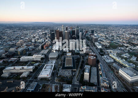 Los Angeles, California, USA - February 20, 2018:  Aerial view of urban downtown Los Angeles skyline before sunrise. Stock Photo