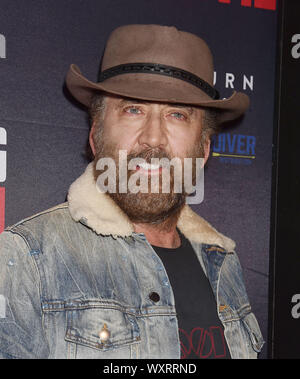 BEVERLY HILLS, CA - SEPTEMBER 16: Nicolas Cage attends the Premiere Of Quiver Distribution's 'Running With The Devil' at Writers Guild Theater on September 16, 2019 in Beverly Hills, California. - Stock Photo
