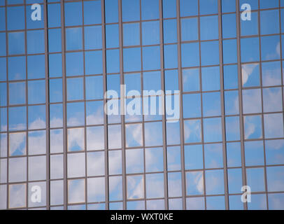 Business center. Glass facade background blue sky reflection. Modern architecture. Construction and design. Commercial property or real estate. Real estate concept. Sale and purchase of buildings. - Stock Photo