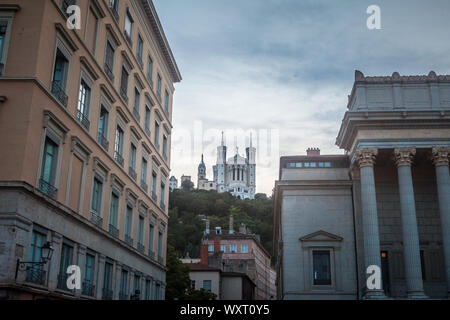 LYON, FRANCE - JULY 13, 2019: Basilique Notre Dame de Fourviere Basilica church in Lyon, France, surrounded by historic buildings of The Fourviere Hil - Stock Photo