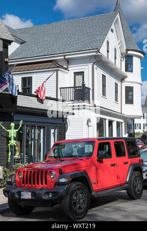 American red Jeep parked by Bar and Restaurant at Manchester-by-the-Sea. Massachusetts, USA - Stock Photo