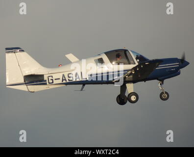 G-ASAL, the only Model 124 Scottish Aviation Bulldog, and former company demonstrator, departing from its home base at Prestwick Airport in Ayrshire. - Stock Photo
