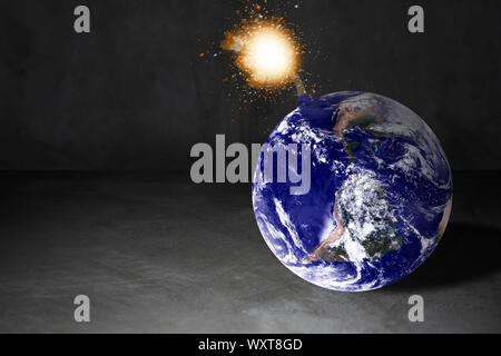 World crisis concept, the earth bomb background, Elements of this image furnished by NASA - Stock Photo