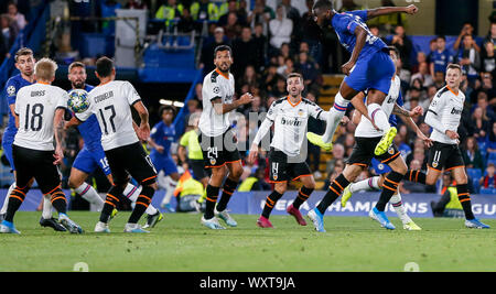 London, UK. 17th Sep, 2019. Chelsea's Fikayo Tomori (Above) heads for the ball which falls on the arm of Valencia's Daniel Wass (2nd L) that causes a handball penalty during the UEFA Champions League Group H match between Chelsea and Valencia at Stamford Bridge Stadium in London, Britain on Sept. 17, 2019. Chelsea lost 0-1. Credit: Han Yan/Xinhua/Alamy Live News - Stock Photo