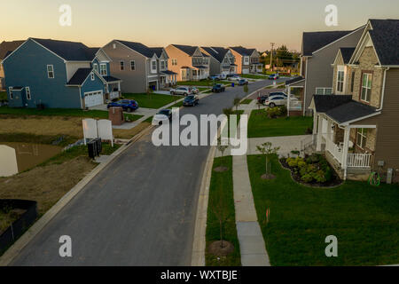Aerial view of typical American new construction neighborhood street in Maryland for the upper middle class, single family homes USA real estate - Stock Photo