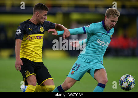 Frenkie de Jong of FC Barcelona (R) and Thorgan Hazard of Dortmund are seen in action during the UEFA Champions League match between Borussia Dortmund and FC Barcelona at the Signal Iduna Park in Dortmund.(Final score; Borussia Dortmund 0:0 FC Barcelona) - Stock Photo