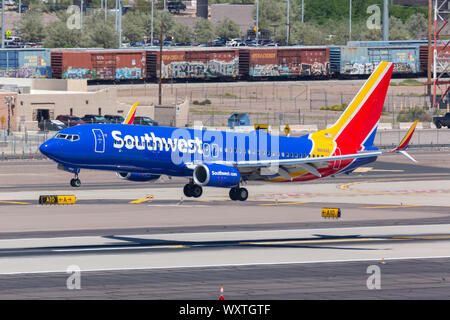 Phoenix, Arizona – April 8, 2019: Southwest Airlines Boeing 737-800 airplane at Phoenix Sky Harbor airport (PHX) in the United States. - Stock Photo