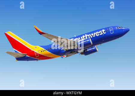 Phoenix, Arizona – April 8, 2019: Southwest Airlines Boeing 737-700 airplane at Phoenix Sky Harbor airport (PHX) in the United States. - Stock Photo