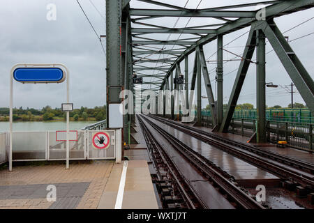 Old rusty railroad bridge over the Danube River in Vienna Austria - Stock Photo
