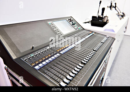 Digital professional audio mixing console in store - Stock Photo