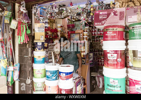 Kolkata, West Bengal, India 1st January, 2019 - A paint seller shop owner working inside his hardware store. - Stock Photo
