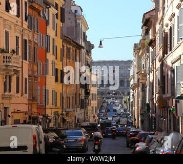 Rome, looking down the Via dei Serpenti towards the Colosseum on a summer's day.