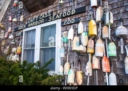Oak shingles and colourful lobster buoys at Captain Cass - Cap't Cass Rock Harbor Seafood Cafe at Orleans, Cape Cod, New England, USA - Stock Photo