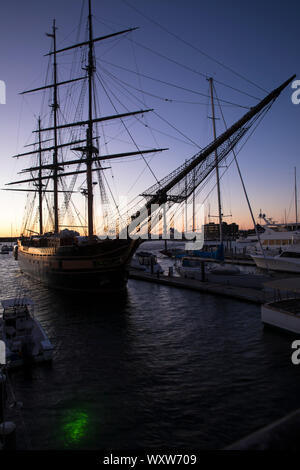 Impressive sailing ship Oliver Hazard Perry with traditional rigging moored in harbor at Newport, Rhode Island, USA - Stock Photo