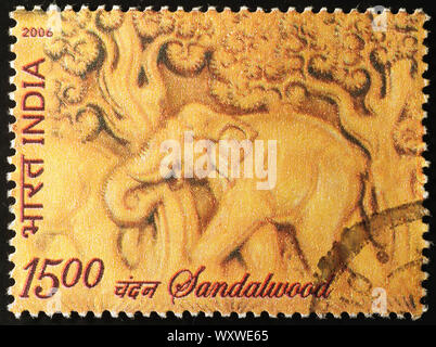 Elephant carved on sandalwood in indian postage stamp - Stock Photo