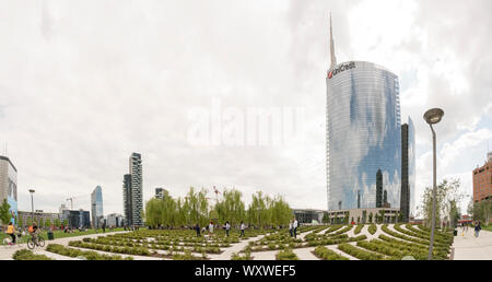 """Milan, Italy: new buildings in Milan, the Unicredit Bank headquarters skyscraper seen from the public park called """"Library of trees"""" - Stock Photo"""