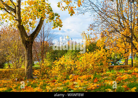 Veliky Novgorod, Russia. St Sophia Cathedral and bell tower in the Kremlin park in Novgorod, Russia - frame composition with autumn trees. Architectur - Stock Photo