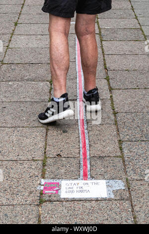 Germany,Berlin, Mitte,Weinbergsweg, September 2019. Pink rebel sticker Advertising the world global climate strike on September 20, 2019 just ahead of a UN emergency climate summit. Young people continue to alert the world to the alarming climate crises in their 'Fridays for the Future' protests. Slogan on pavement says 'Stay on the line for good Karma' - Stock Photo