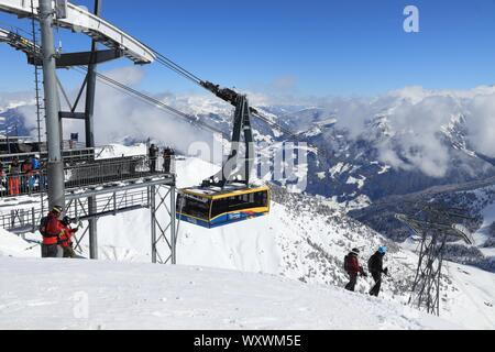 MAYRHOFEN, AUSTRIA - MARCH 12, 2019: People visit Mayrhofen ski resort in Tyrol region, Austria. The resort is located in Zillertal valley of Central - Stock Photo
