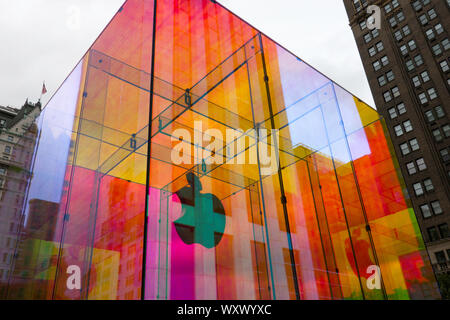 The iconic Apple store glass cube is in a temporary iridescent wrap, Fifth Avenue, NYC, USA - Stock Photo