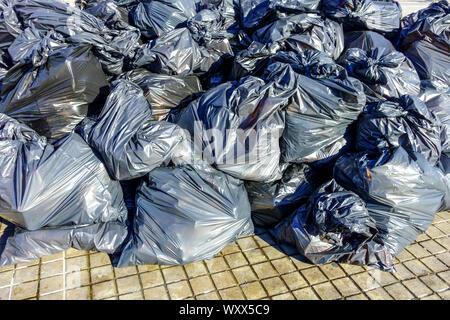 Pile of full plastic bags of garbage