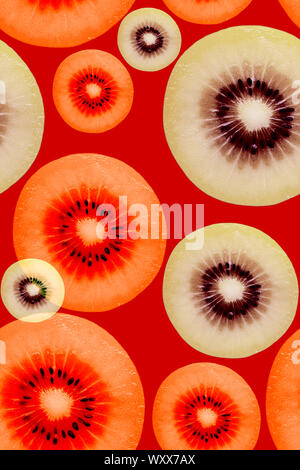 Creative seamless hypnotic pattern of kiwi slice in bold neon colors on red or scarlet background in pop-art style.Photography collage - Stock Photo