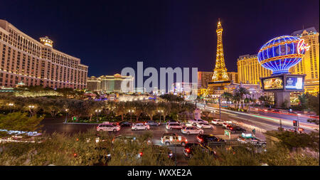 A skyline nighttime view of several casino's and resort on Las Vegas Blvd in Las Vegas, Nevada including the Fountains at Bellagio water show. - Stock Photo