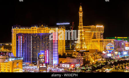 A skyline nighttime view of several casino's and resort on Las Vegas Blvd in Las Vegas, Nevada. - Stock Photo