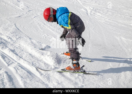 Boy learning skiing - down the slope - czech ski resort. Spinleruv Mlyn, Czech Republic. - Stock Photo