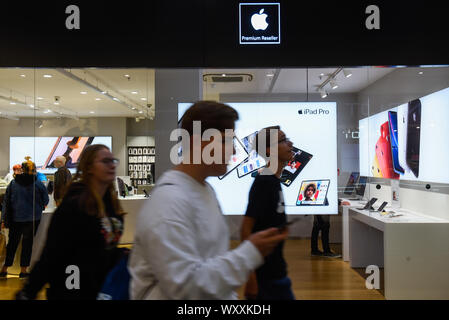 Krakow, Poland. 18th Sep, 2019. People walk by an Ispot sales point. Apple is to release the new Iphone 11 on September 20th. Credit: Omar Marques/SOPA Images/ZUMA Wire/Alamy Live News - Stock Photo