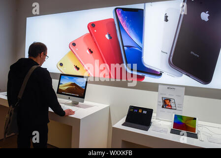 Krakow, Poland. 18th Sep, 2019. A man tests an Apple iMac at an Ispot sales point. Apple is to release the new Iphone 11 on September 20th. Credit: Omar Marques/SOPA Images/ZUMA Wire/Alamy Live News - Stock Photo