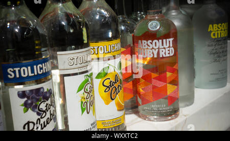 A selection of bottles of top shelf liquor displayed in the window of a bar in Midtown Manhattan in New York on Saturday, September 7, 2019.  (© Richard B. Levine) - Stock Photo