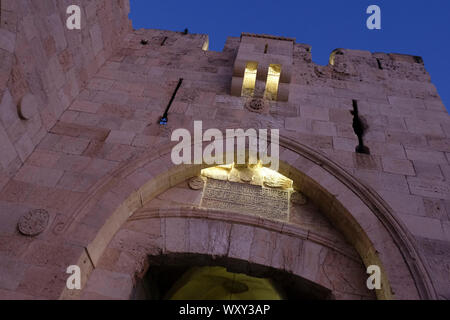 Arabic inscription in the stone portal of Jaffa Gate one of eight gates of the Ottoman walls of the Old City of East Jerusalem Israel - Stock Photo