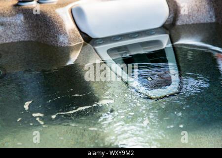 Closeup of water in hot bath tubs at spa - Stock Photo