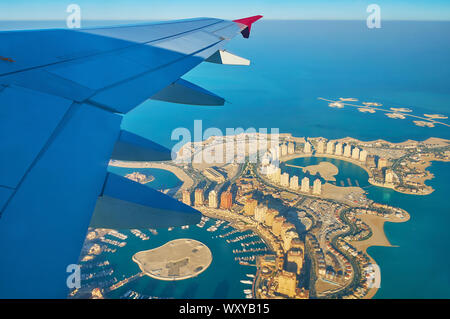 Aerial view on the fantastic landscape and modern architecture of man-made Pearl-Qatar Island and Isola Dana islets' chain, situated at the coast of D - Stock Photo