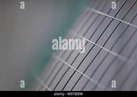 New green mesh fence, macro photo, selective art focus - Stock Photo