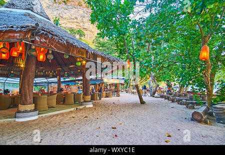 AO NANG, THAILAND - APRIL 25, 2019: The beach bar in wooden hut is decorated with many lanterns, making it cozy and romantic, on April 25 in Ao Nang - Stock Photo