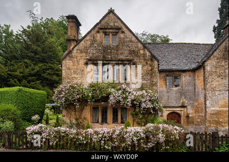 Beautiful and typical Cotswold Stone house in the Cotswold village of Stanway, Gloucestershire, Cotswolds, UK - Stock Photo