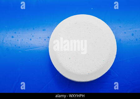 Chlorine Pellets on the edge of an inflatable pool - Stock Photo