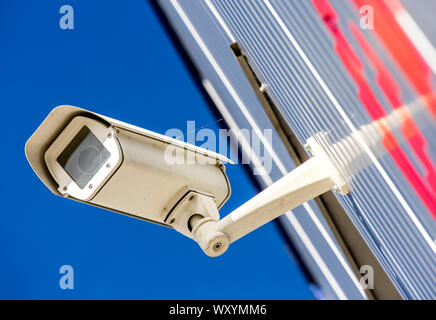 closeup on security CCTV camera or surveillance system in office building - Stock Photo