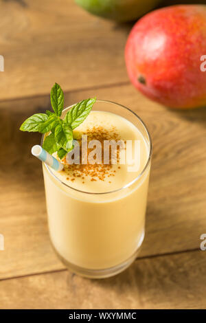 Homemade Sweet Indian Mango Lassi Smoothie with Mint - Stock Photo
