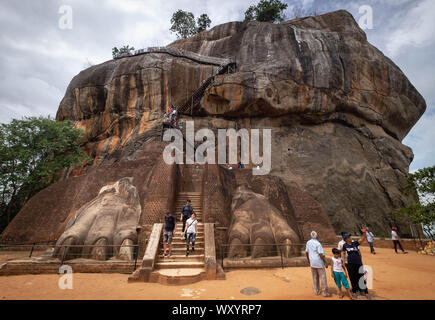 Sigiriya / Sri Lanka- AUGUST 08-2019: The entrance to the Sigiriya Lion rock fortress in Sigiriya, Sri Lanka. Unsprcific traveller at the entrance of - Stock Photo