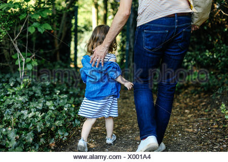 Father and little girl enjoying nature walk - Stock Photo